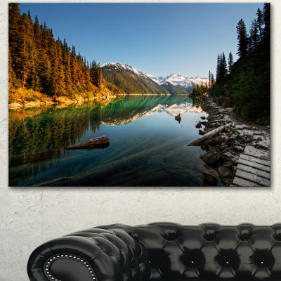 Designart Snowy Path Along Mountain Lake LandscapeCanvas Art Print - 3 Panels