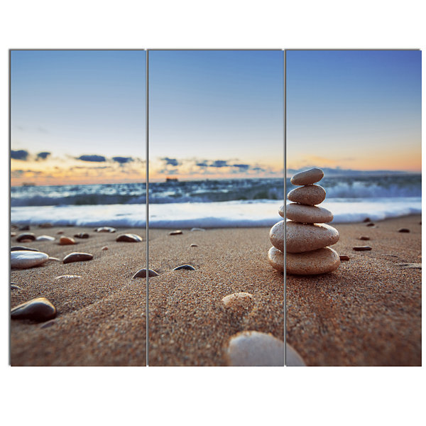 Designart Stones Balance On Sandy Beach SeashoreCanvas Art Print - 3 Panels