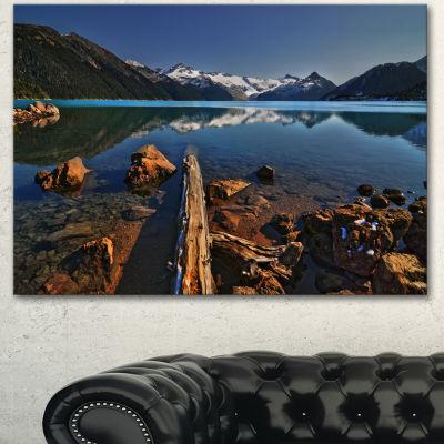 Designart Large Logs In Mountain Lake Extra LargeLandscape Canvas Art Print