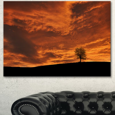 Designart Lonely Tree Under Brown Sky Landscape Canvas Art Print
