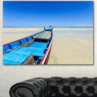 Designart Long Tail Boat Stand At The Beach Seashore Canvas Art Print