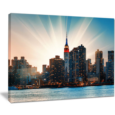 Designart Manhattan Skyline At Bright Sunset ExtraLarge Canvas Art Print