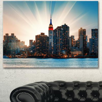 Designart Manhattan Skyline At Bright Sunset ExtraLarge Canvas Art Print - 3 Panels