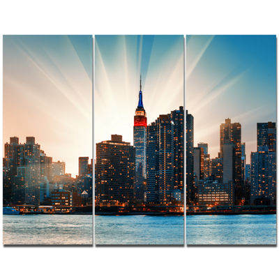 Designart Manhattan Skyline At Bright Sunset LargeCanvas Art Print - 3 Panels