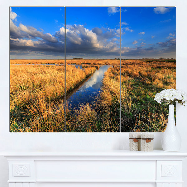 Designart Meadow Land With Beautiful SkyscrapersLandscape Canvas Art Print - 3 Panels