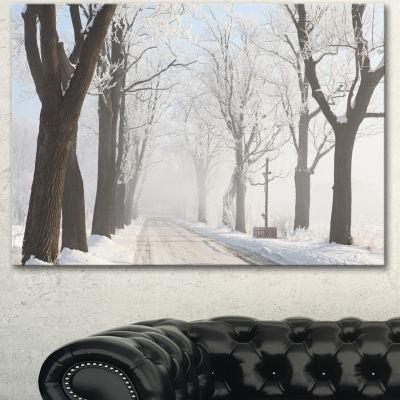 Designart Misty Rural Road In Winter Forest LargeForest Canvas Art Print