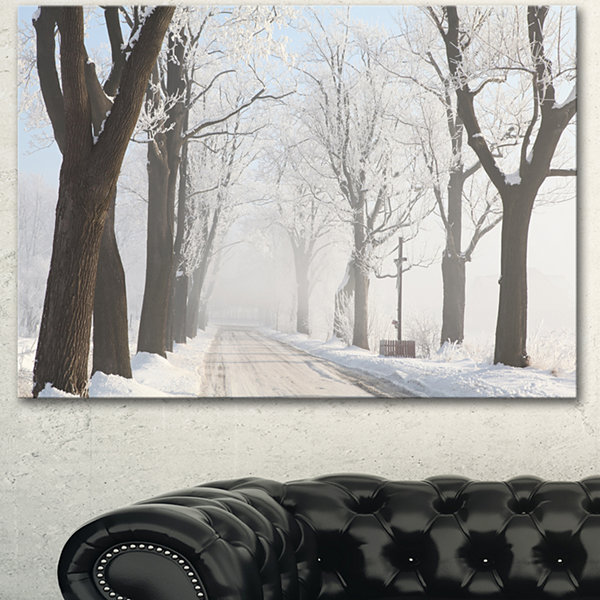Designart Misty Rural Road In Winter Forest LargeForest Canvas Art Print