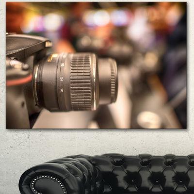 Designart Modern Camera In City Electronics ShopContemporary Canvas Art Print