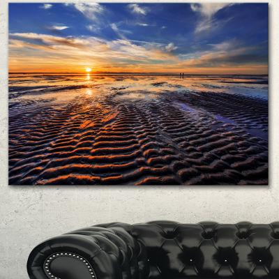 Designart Waves On The Sand During Sunset SeashoreCanvas Art Print - 3 Panels