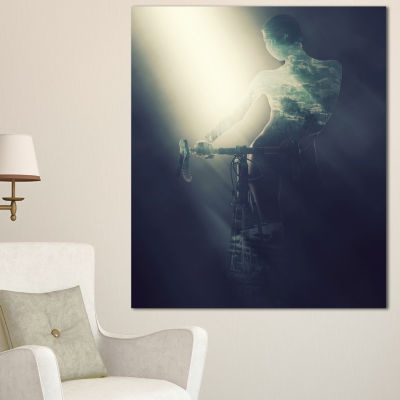 Designart Woman With Bicycle In Spotlight PortraitCanvas Art Print - 3 Panels