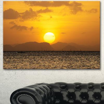 Designart Yellow Sunset And Brown Ocean SeashoreCanvas Art Print