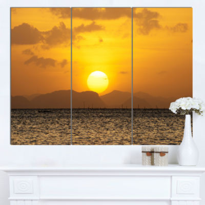 Designart Yellow Sunset And Brown Ocean Seashore Canvas Art Print - 3 Panels