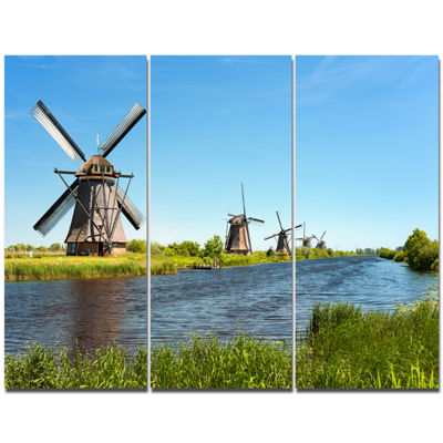Designart Windmills At Kinderdijk Landscape CanvasArt Print - 3 Panels