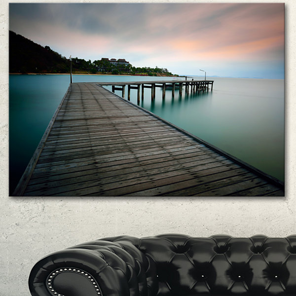 Designart Wooden Bridge Into Blue Sea Modern Canvas Art Print - 3 Panels