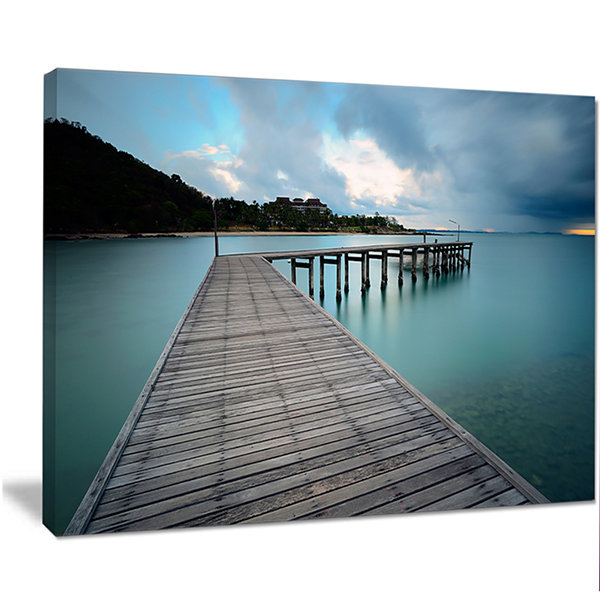 Designart Wooden Bridge To Calm Ocean Modern Canvas Art Print