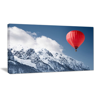 Designart Balloon Over Winter Hills Landscape Canvas Art Print
