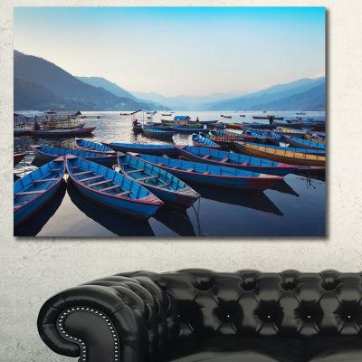 Designart Blue Wooden Boats In Lake Boat Canvas Art Print