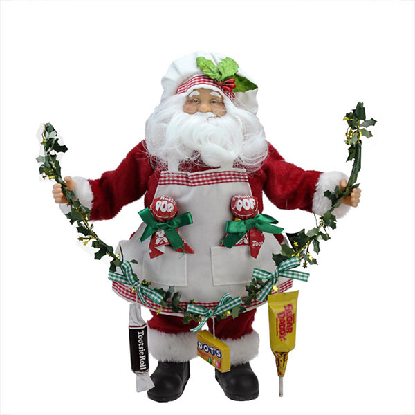 Quot santa claus holding a garland with tootsie candies