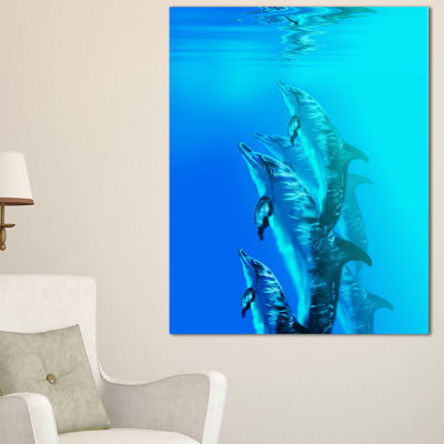 Designart Dolphin In Blue Sea Seascape Canvas ArtPrint