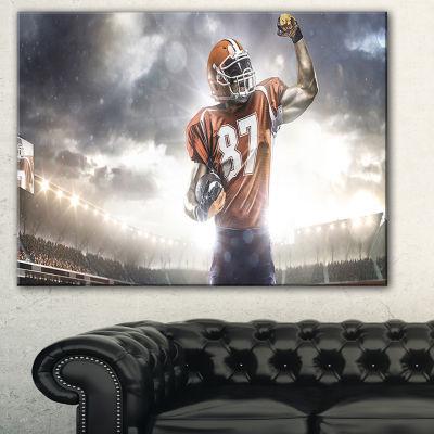 Designart American Footballer On Stadium Sport Canvas Art Print