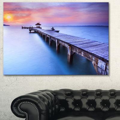 Designart Blue Wooden Bridge Seascape PhotographyCanvas Art Print - 3 Panels