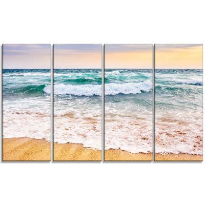 Designart Foaming Waves Splashing The Sand Seascape Canvas Art Print - 4 Panels