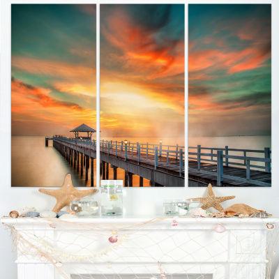 Designart Wooden Bridge Under Colorful Sky Sea Bridge Canvas Art Print - 3 Panels