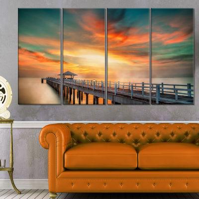 Designart Wooden Bridge Under Colorful Sky Sea Bridge Canvas Art Print - 4 Panels