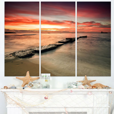 Designart Wonderful Sunrise On Black Ocean Beach Photo Canvas Print - 3 Panels