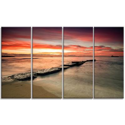 Designart Wonderful Sunrise On Black Ocean Beach Photo Canvas Print - 4 Panels