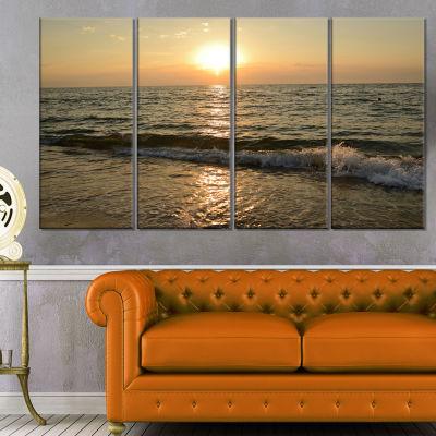 Designart Black Seascape In Morning Sunlight BeachPhoto Canvas Print - 4 Panels