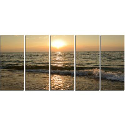Designart Black Seascape In Morning Sunlight BeachPhoto Canvas Print - 5 Panels