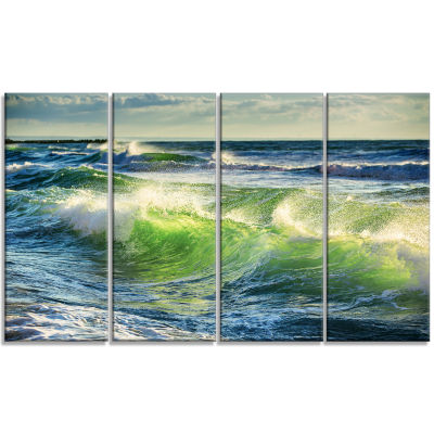 Designart Sunrise And Shining Waves In Ocean BeachPhoto Canvas Print - 4 Panels