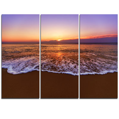 Designart Orange Tinged Sea Waters At Sunset BeachPhoto Canvas Print - 3 Panels