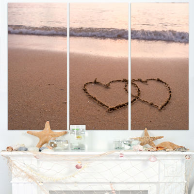 Designart Two Hearts Drawn On The Beach Seascape Art Canvas - 3 Panels