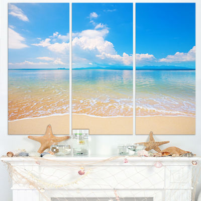 Designart Clouds Over Calm Beach Seashore Photo Canvas Print - 3 Panels