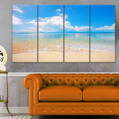 Designart Clouds Over Calm Beach Seashore Photo Canvas Print - 4 Panels