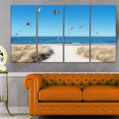 Designart Beach With Seagulls In Rugen Island Seascape Canvas Art Print - 4 Panels
