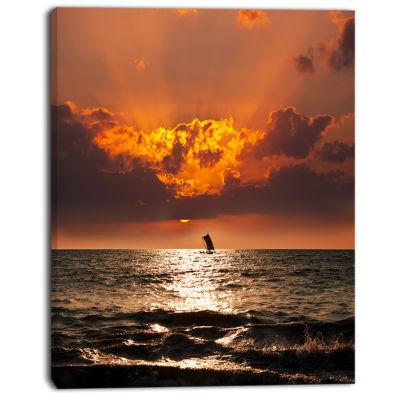 Designart Sunset Beach With Distant Sail Boat Seashore Canvas Art Print