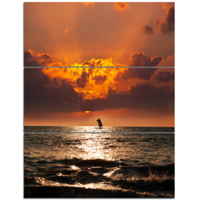 Designart Sunset Beach With Distant Sail Boat Seashore Canvas Art Print - 3 Panels