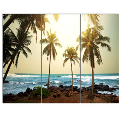 Designart Rocky Tropical Beach With Palms SeashoreCanvas Art Print - 3 Panels