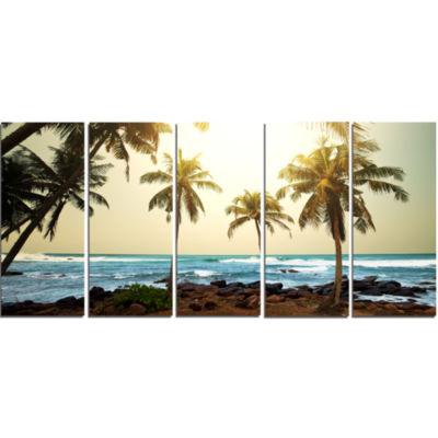 Designart Rocky Tropical Beach With Palms SeashoreCanvas Art Print - 5 Panels