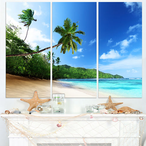 Designart Sunset Beach With Palm Landscape Photography Canvas Art Print - 3 Panels
