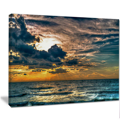 Designart Sun Break Over Blue Ocean Seashore Canvas Art Print