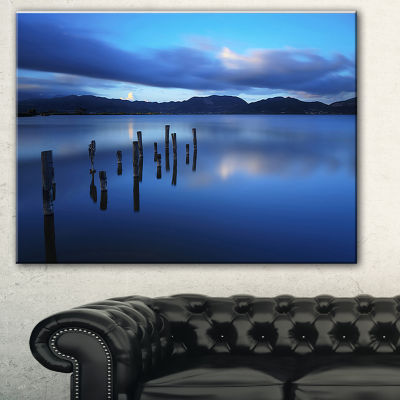 Designart Dark Blue Sea With Pier Remains SeascapeCanvas Art Print - 3 Panels