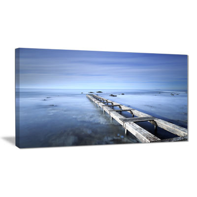 Designart Dark Blue Sky And Large Pier Seascape Canvas Art Print