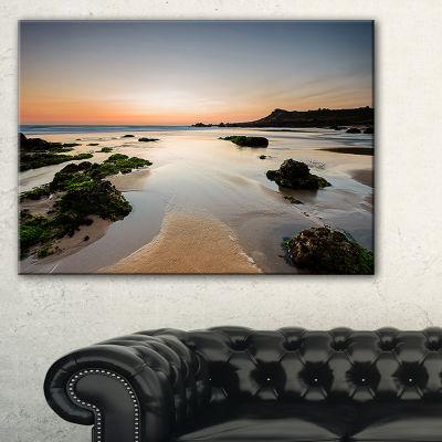 Designart Dark Waters At Sunset Seashore Photography Canvas Print
