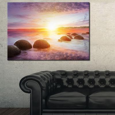 Designart Evening Sun Over Moeraki Boulders Seashore Photo Canvas Print