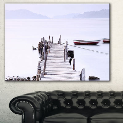 Designart Foggy Sea With Pier And Boats SeascapeCanvas Art Print
