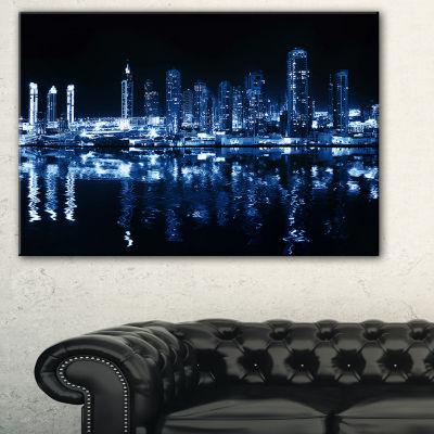 Designart Glowing City At Midnight Cityscape PhotoCanvas Print - 3 Panels